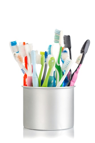 Aluminum can full of toothbrushes